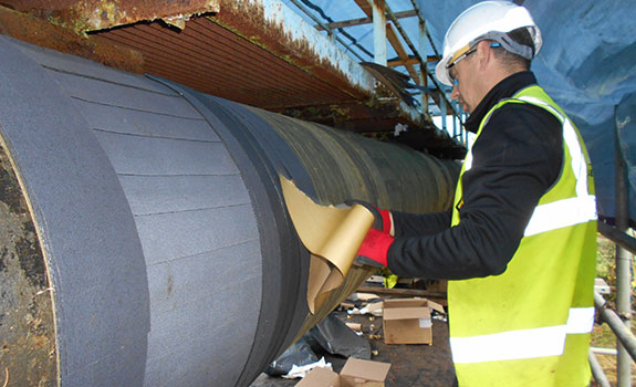 Wrapping the pipe with Denso Ultraseal Tape™