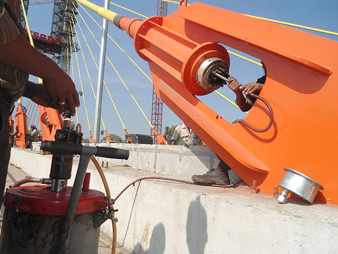 Denso Void Filler™ Type I is pumped hot or cold into tensioning cables of bridge