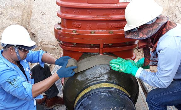 Denso Tape is spirally wrapped around Densyl Mastic on valve Thailand